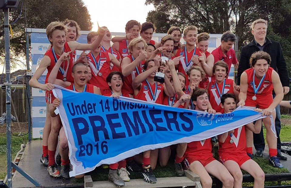East Brighton Vampires accepting their Premiership AFL Trophy